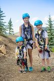 Group of Children ready to go on a zipline adventure Royalty Free Stock Images