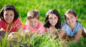 Group of children resting in camp Stock Photos