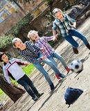 Group of children running after ball Stock Photography