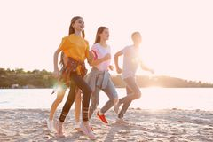 Group of children running on beach. Summer camp. Group of active children running on beach. Summer camp stock photography
