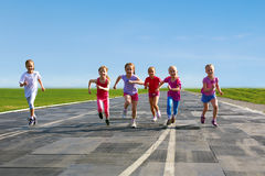 Group of children running Stock Image