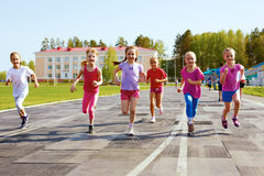 Group of children running on the treadmill. At the stadium Stock Photography