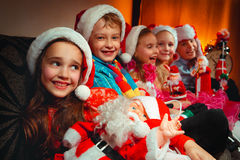 Group of children with Santa Claus Stock Images