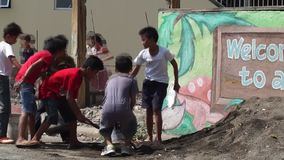 A group of children shovel sand stock video footage