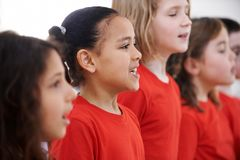 Group Of Children Singing In Choir Together royalty free stock photography