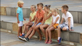 Group of children sitting on bench