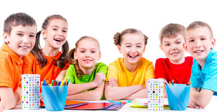 Group of children sitting at a table. Royalty Free Stock Images