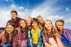 Group of children sitting together and smile Royalty Free Stock Photos