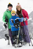 Group Of Children On Ski Holiday In Mountains Stock Photos