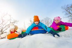 Group of children sliding on the colorful tubes Stock Photography