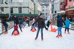 Group of children slipping on an ice rink Stock Photography
