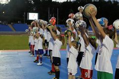 A group of children at the stadium holds a raised ball in their hand, Puławy, 05.2012, Poland stock image
