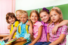 Group of children stand close to each other hug Royalty Free Stock Images