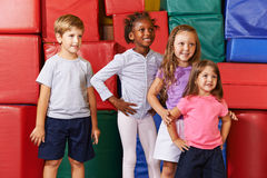 Group of children standing in gym Stock Image