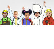 Group of Children Standing in a Variation Uniform Royalty Free Stock Photography