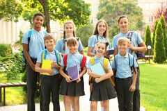 Group of children in stylish school uniform. Outdoors stock photos