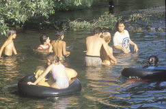 A group children swimming in a river near Ojai, CA Stock Photo