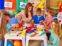 Group children with teacher in preschool. Group children with female teacher in preschool kindergarten painting stock images