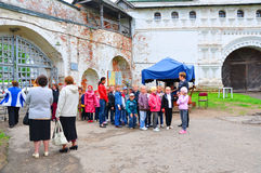 A group of children in the territory Goritsky monastery in Pereslavl-Zalesskiy, Russia royalty free stock images