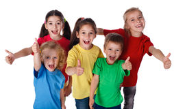 Group of children with thumbs up sign. Group of happy children with thumbs up sign, isolated on white stock photography