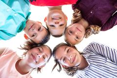 Group Of Children of Various Ages Standing in Circle, Looking Down Into Camera. royalty free stock photography