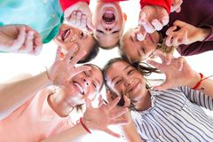 Group Of Children of Various Ages Standing in Circle, Looking Down Into Camera. stock photography