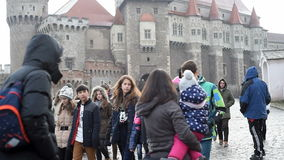 Group of children visiting the Hunyad Castle in Hunedoara, Romania stock video footage