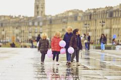 Group of children walking on water mirror Stock Photos