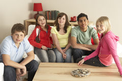 Group Of Children Watching TV At Home. Smiling Royalty Free Stock Photos