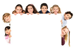 Children. Group of children with a white board isolated in white Stock Images