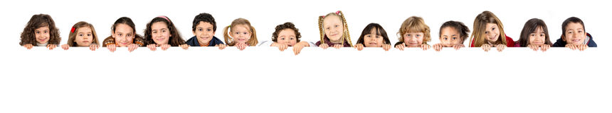 Children. Group of children with a white board isolated in white royalty free stock image