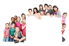 Group of children. With a white board isolated in white Stock Images