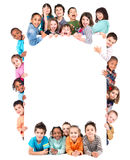 Group of children. With a white board isolated in white Royalty Free Stock Photos