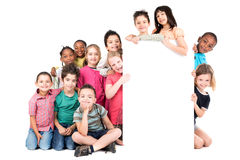 Group of children. With a white board isolated in white Stock Photos