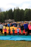 Group of children and young adults helping to roll out balloons at annual festival,Crandall Park, Glens Falls, New York,2014 Royalty Free Stock Photo