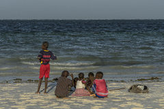 Group of children on Zanzibar beach royalty free stock images