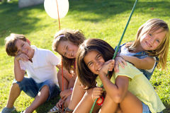 Group of childrens having fun in the park. Stock Images