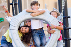 Group of childrens having fun in the park. Royalty Free Stock Photos