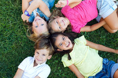Group of childrens having fun in the park. Portrait of group of childrens having fun in the park stock photography