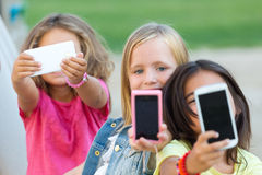 Group of childrens taking a selfie in the park. Stock Photo