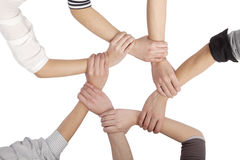 Group of Chinese friends with hands in circle Stock Image