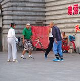 Group of Chinese People were playing a shuttle in the late stock image