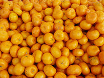 Group of Chinese small oranges,. The group of Chinese small oranges, Many fresh fruit close up background Stock Images