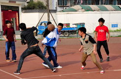 Pengzhou, China: Youths Playing Basketball Royalty Free Stock Image