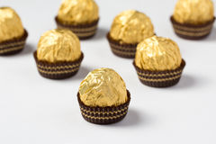 Group of chocolate candies. Wrapped in golden foil Royalty Free Stock Image