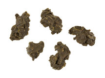 Group Chocolate Clusters On White. A group of chewy and crunchy chocolate clusters on a white background Stock Images