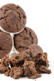 Group of chocolate muffins and crumbs- Isolated on white Royalty Free Stock Photo