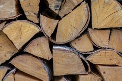Group chopped logs pile of firewood background rustic close-up design cracked light beige royalty free stock photography