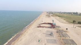 Group Choreography on The Beach.Aerial Photography stock video