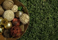 Group of Christmas ball in the basket on green grass. Group of Christmas ball in wooden basket on green grass in Thailand stock images